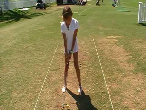 Vicka en su primera clase de golf